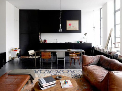 Interior: Black kitchen, Brown sofa