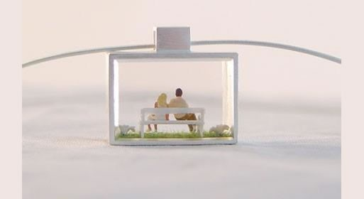 young couple on bench pendant designed by anne gericke